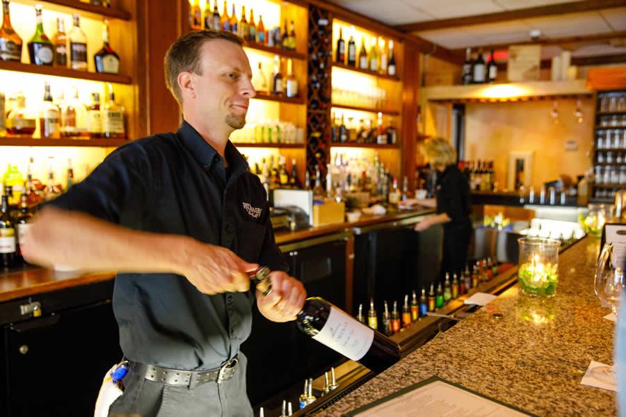 Steven Uncorks Wine at Ridgway Bar